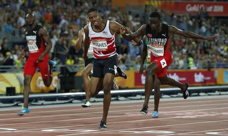 Athletics - Gold Coast 2018 Commonwealth Games - Men's 200m - Final - Carrara Stadium - Gold Coast, Australia - April 12, 2018. Zharnel Hughes of England in action with Jareem Richards of Trinidad and Tobago. REUTERS/Paul Childs