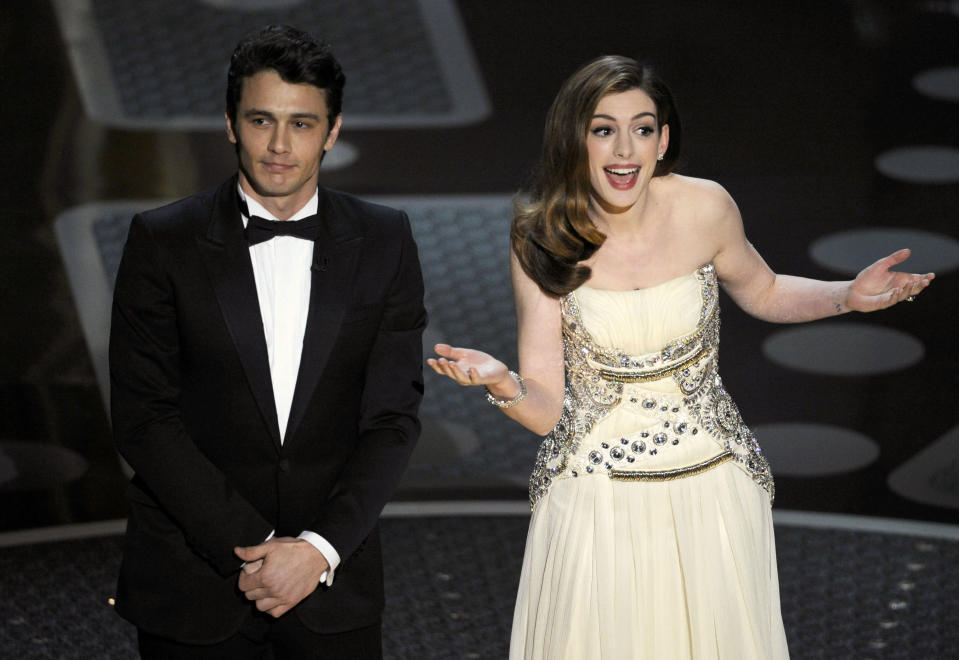 Hosts James Franco, left, and Anne Hathaway are seen onstage during the 83rd Academy Awards on Sunday, Feb. 27, 2011, in the Hollywood section of Los Angeles. (AP Photo/Mark J. Terrill)