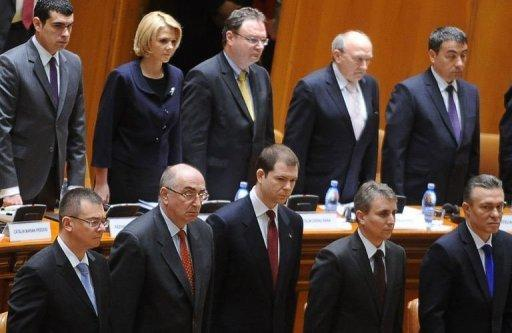 Romanian Prime Minister Mihai Razvan Ungureanu (bottom left) stands next to government members in the parliament in Bucharest. Romania's centre-right government has collapsed after a no-confidence vote, jeopardising key reforms six months ahead of general elections
