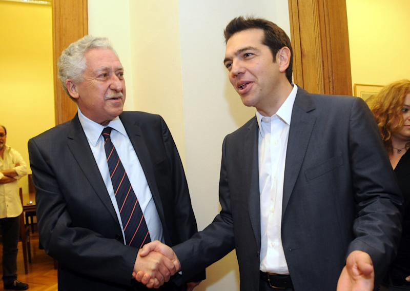 Greek leader of Coalition of the Radical Left party (SYRIZA), Alexis Tsipras, right, and leader of the Democratic Left party, Fotis Kouvelis, smile before their meeting at the Greek Parliament in Athens, Tuesday, May 8, 2012. Greece's commitment to austerity is no longer valid because voters have rejected those deals, Tsipras declared Tuesday as he tried to form a new coalition government. (AP Photo/Evi Fylaktou)