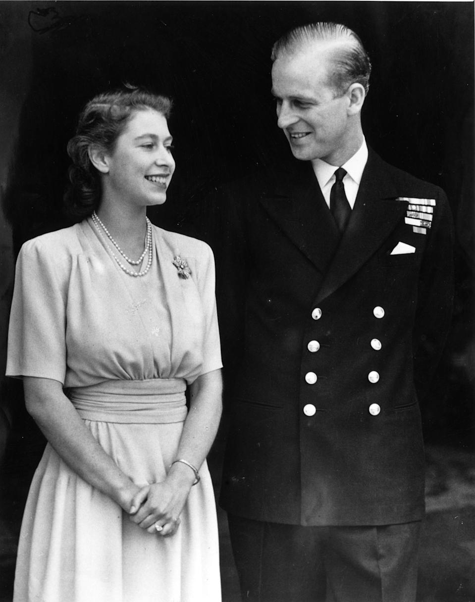 <p>The newly-engaged couple beamed at each other on July 10, 1947, almost a year after Prince Philip proposed in secret. Elizabeth's father, King George VI, asked for the public announcement be delayed until the princess's 21st birthday. Photo: Getty Images.</p>
