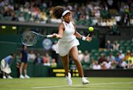 Naomi Osaka of Japan plays a forehand in her Ladies' Singles first round match against Yulia Putintseva of Kazakhstan during Day one of The Championships - Wimbledon 2019 at All England Lawn Tennis and Croquet Club on July 01, 2019 in London, England. (Photo by Shaun Botterill/Getty Images)