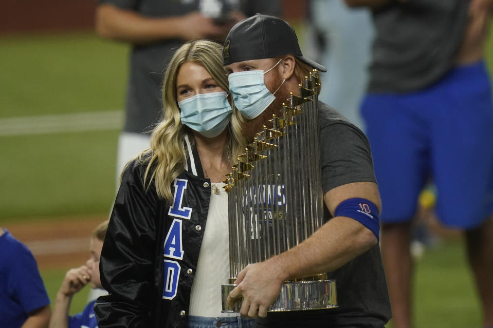 Los Angeles Dodgers third baseman Justin Turner celebrates with the trophy after defeating the Tampa Bay Rays 3-1 to win the baseball World Series in Game 6 Tuesday, Oct. 27, 2020, in Arlington, Texas. (AP Photo/Eric Gay)
