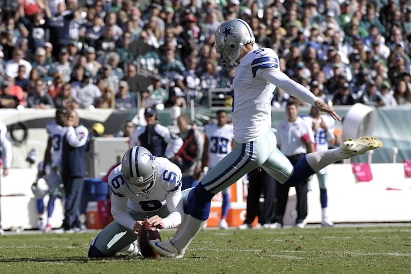 Dallas Cowboys kicker Dan Bailey, right, with Chris Jones holding, kicks a field goal against the Philadelphia Eagles during the first half of an NFL football game, Sunday, Oct. 20, 2013, in Philadelphia. (AP Photo/Michael Perez)