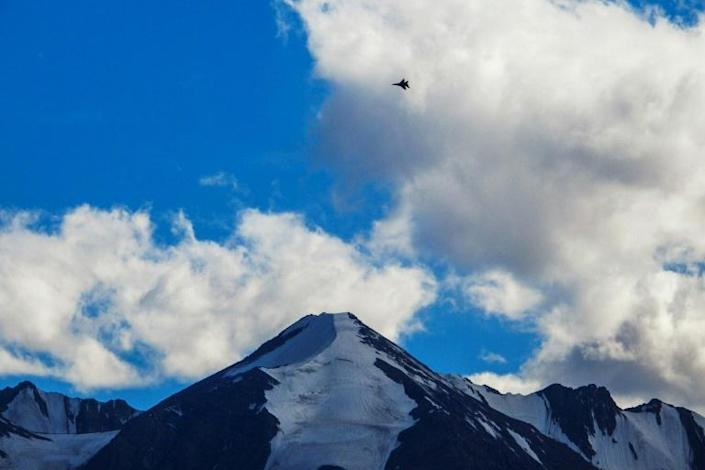 An Indian fighter jet flies over a mountain range in Leh, the joint capital of the union territory of Ladakh