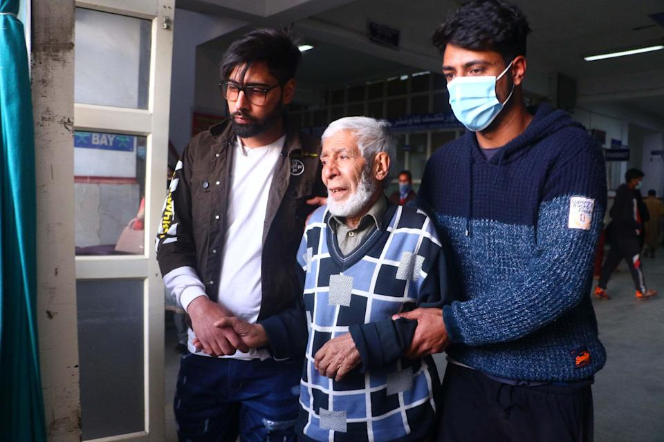 Father of slain army man who was killed by unknown gunmen at Bijbehara, Anantnag being consled by relatives