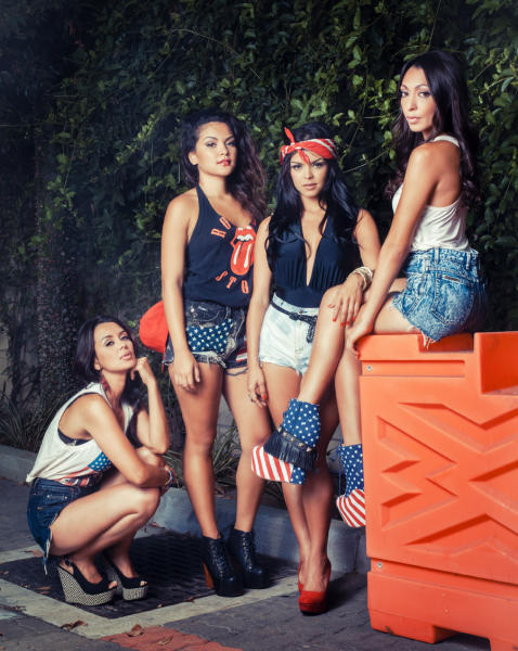 """This image released by We TV shows, from left, Jamie Hernandez, Presley Hernandez, Tahiti Hernandez, Tiara Hernandez, sisters of entertainer Bruno Mars, who will star in a reality series on We TV documenting the recording process of their debut album. """"The Lylas"""" will include Tiara, Tahiti and Presley, who are moving from Hawaii to Los Angeles to join older sister Jamie. The show does not have a premiere date, but will air this fall on Fridays. It will include eight hour-long episodes. (AP Photo/We TV)"""