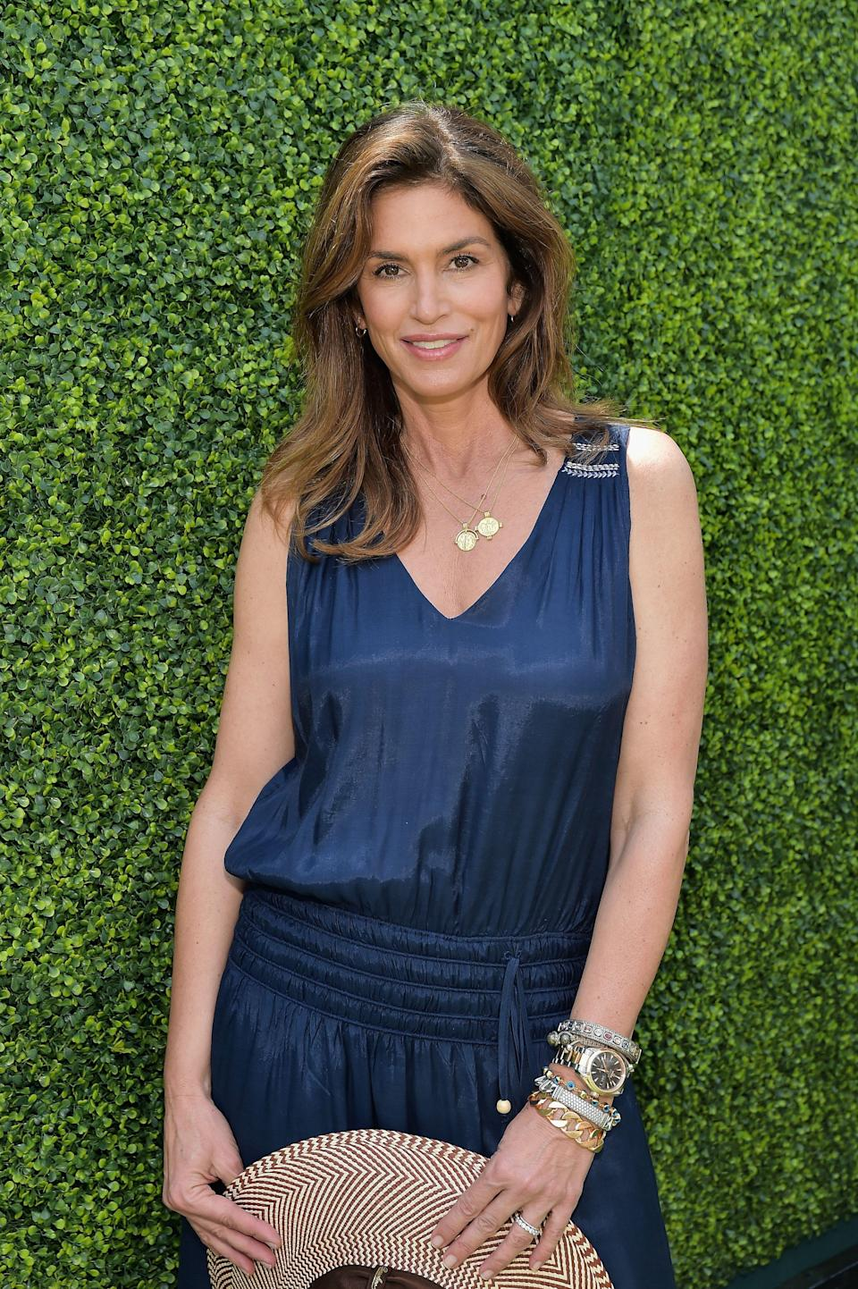 """<p>Scrolling through <a href=""""https://www.instagram.com/cindycrawford/?hl=en"""" rel=""""nofollow noopener"""" target=""""_blank"""" data-ylk=""""slk:Cindy Crawford's Instagram feed"""" class=""""link rapid-noclick-resp"""">Cindy Crawford's Instagram feed</a> is like taking a master class in how to make 54 look every bit as fun, fit, and fab as ever.</p><p>So, how has the OG supermodel managed to maintain her <a href=""""https://www.womenshealthmag.com/uk/health/"""" rel=""""nofollow noopener"""" target=""""_blank"""" data-ylk=""""slk:health"""" class=""""link rapid-noclick-resp"""">health</a> and <a href=""""https://www.womenshealthmag.com/uk/fitness/"""" rel=""""nofollow noopener"""" target=""""_blank"""" data-ylk=""""slk:fitness"""" class=""""link rapid-noclick-resp"""">fitness</a> game this strong...for this long? Consistency. After all, it is the key to seeing (and keeping) any significant gains when it comes to your general well-being. On that front, it's clear that, for Cindy, a big part of maintaining balance is working out regularly, which she documents on her social media account. Her feed is peppered with images and videos of her breaking a sweat. So, what are Cindy's favourite forms of fitness? Read on to see how America's favourite supermodel stays fit these days. </p>"""
