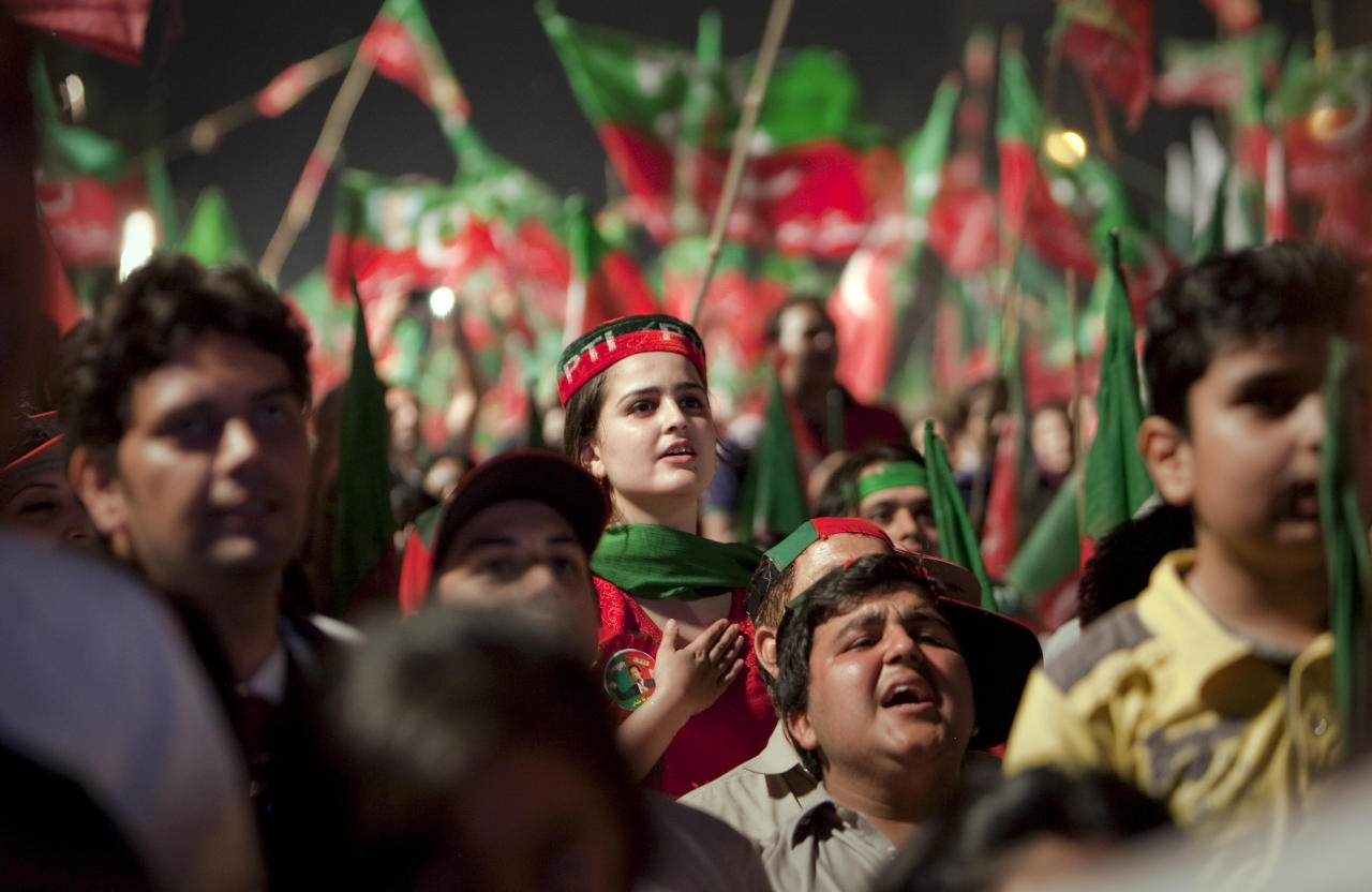 Supporters of Pakistan Tehreek-e-Insaf or Moment for Justice party sing national anthem during an election campaign rally in Islamabad, Pakistan, Thursday, May 9, 2013. Pakistan is scheduled to hold parliamentary elections on May 11, the first transition between democratically elected governments in a country that has experienced three military coups and constant political instability since its creation in 1947. The parliament's ability to complete its five-year term has been hailed as a significant achievement. (AP Photo/Anjum Naveed)