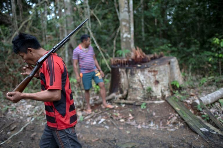 Arara indigenous chief Tatji Arara (L), 41, patrols his ancestral lands in northern Brazil, where illegal logging is a major problem