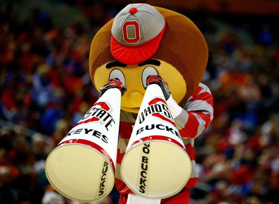 BUFFALO, NY - MARCH 20: The Ohio State Buckeyes mascot, Brutus Buckeye, performs during the second round of the 2014 NCAA Men's Basketball Tournament against the Dayton Flyers at the First Niagara Center on March 20, 2014 in Buffalo, New York.  (Photo by Jared Wickerham/Getty Images)