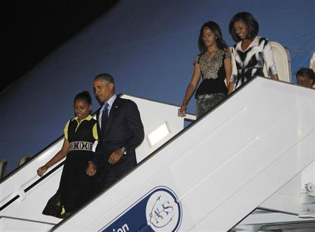U.S. President Barack Obama and first lady Michelle Obama arrive with their daughters Sasha and Malia in Dakar