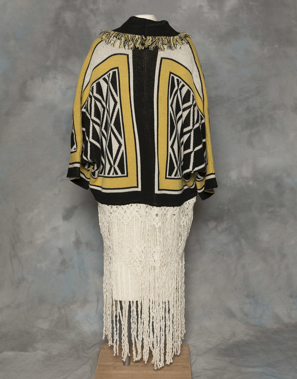 "In this undated photo provided by the Sealaska Hertiage Institute in Juneau, Alaska, is the back of a Tlingit Ravenstail coat. An Alaska Native cultural organization and the luxury department store Neiman Marcus have settled a lawsuit over the sale of a coat with a copyrighted, geometric design borrowed from indigenous culture. The Sealaska Heritage Institute said in a statement on Wednesday, March 3, 2021, that it has agreed to work with Neiman Marcus and 11 other defendants to resolve the issue ""under Tlingit law and cultural protocols."" (Brian Wallace/Sealaska Heritage Institute via AP)"