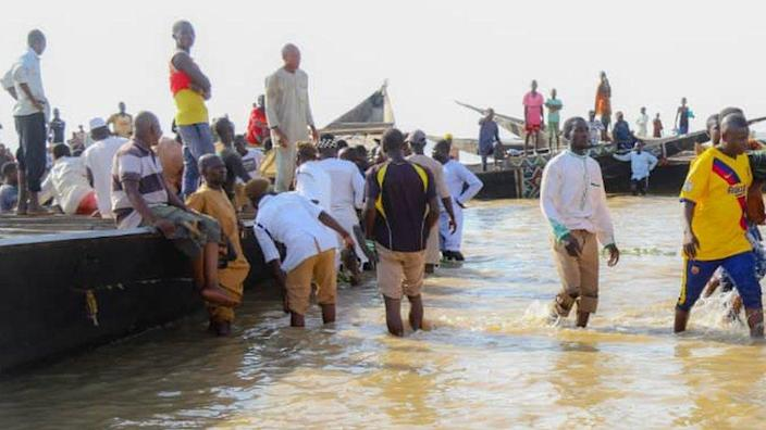 Rescuers at a river after a boat capsized in Nigeria