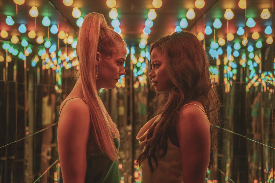 """This image released by A24 shows Riley Keough, left, and Taylour Paige in a scene from """"Zola."""" (Anna Kooris/A24 Films via AP)"""