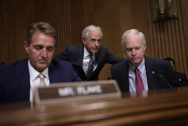 Sen. Bob Corker (R-Tenn.), center, chairman of the Senate Foreign Relations Committee, confers with Sen. Ron Johnson (R-Wis.), right, during a committee hearingNov. 14in Washington, D.C. Also pictured is Sen. Jeff Flake (R-Ariz.).