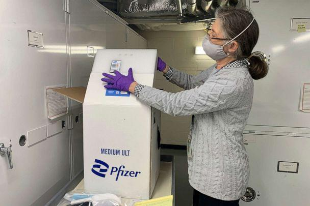PHOTO: Diane Wendt, a curator at the Smithsonian Institution's National Museum of American History, shows a specialized container used to ship super-cold doses of the Pfizer/BioNTech COVID-19 vaccine in Washington, D.C., on March 8, 2021. (Ashraf Khalil/AP)
