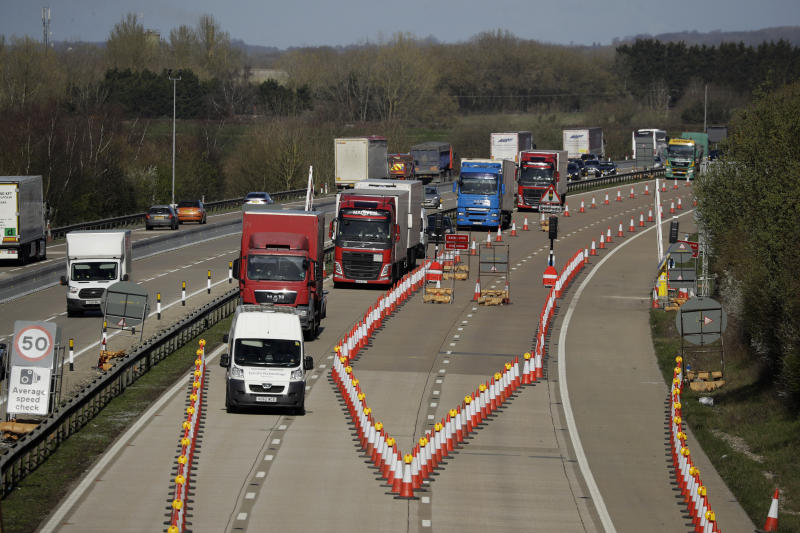 On the first day of Operation 'Brock', (Brexit Operations Across Kent) traffic passes through a contraflow system being tested on one side of the M20 motorway near Ashford, Kent, in south east England, Monday, March 25, 2019. The contraflow is designed to manage queues of trucks heading to Europe, via ferries or the Eurotunnel to France, in the event of a no-deal Brexit, to prevent gridlock for other road users. (AP Photo/Matt Dunham)