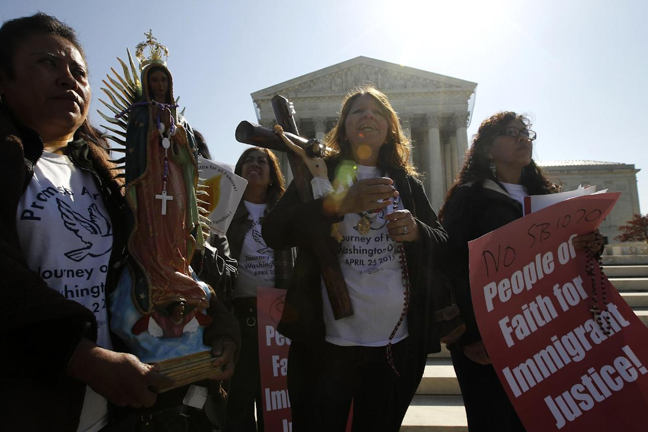 "Opponents of Arizona's ""show me your papers"" immigration law rally in front of the Supreme Court in Washington, Wednesday, April 25, 2012, as the court held a hearing . (AP Photo/Charles Dharapak)"