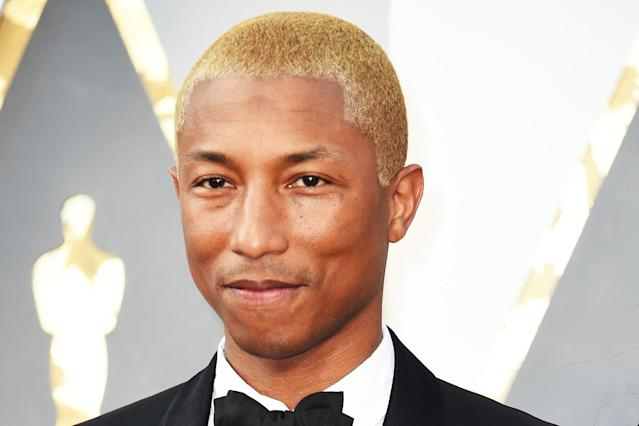 Pharrell Williams at the 2017 Grammy Awards with platinum blond hair. (Photo: Valerie Macon/AFP/Getty Images)