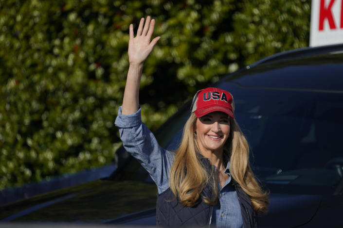 Sen. Kelly Loeffler, R-Ga., waves to a crowd before she speaks at a campaign rally on Saturday, Jan. 2, 2021, in Cumming, Ga. (AP Photo/Brynn Anderson)