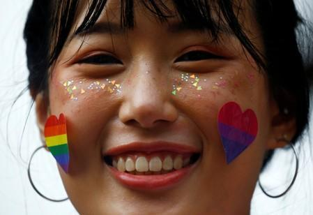FILE PHOTO: A participant of Pink Dot, an annual event organised in support of the LGBT community, is seen at the Speakers' Corner in Hong Lim Park in Singapore