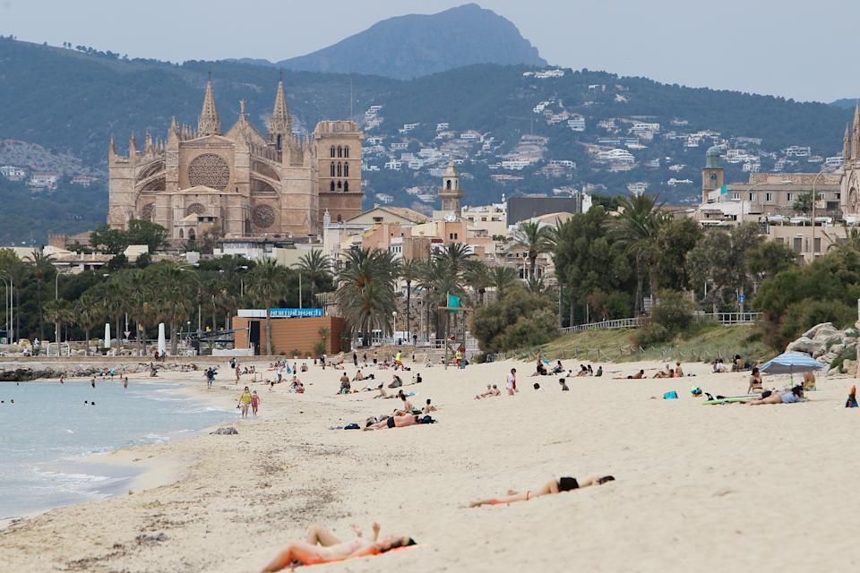 PALMA DE MALLORCA, SPAIN - MAY 25: Swimmers on a beach in Palma during the first day of Phase 2, when it is possible to access beaches in the same province, island or territorial unit of reference established in the de-climbing plan, and when the town halls may establish limitations on access, which in any case will be free, and on capacity to ensure that the interpersonal distance of at least two metres between swimmers is respected. This Monday, Mallorca, Menorca and Ibiza will move on to phase 2 of the government's de-climbing plan, one week after Formentera, which advanced its access to this phase on the 18th of May, just like the islands of El Hierro, La Gomera and La Graciosa in the Canary Islands on May 25, 2020 in Palma de Mallorca, Spain.  (Photo by Isaac Buj/Europa Press via Getty Images)