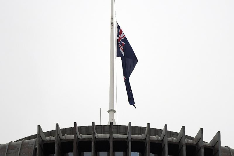 The New Zealand flag hangs at half mast outside the  parliament building in Wellington on Tuesday following last week's mosque massacre