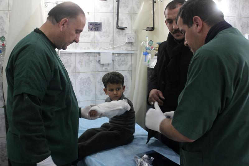 A boy who was wounded in a bomb attack receives treatment at a hospital in Baquba