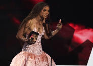Andra Day accepts the best actress award at the BET Awards on Sunday, June 27, 2021, at the Microsoft Theater in Los Angeles. (AP Photo/Chris Pizzello)