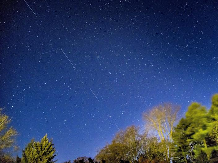 SpaceX Starlink 5 satellites appear in a long-exposure image of the sky from Svendborg on South Funen, Denmark April 21, 2020.