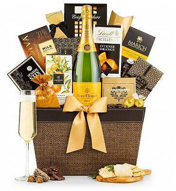 """<p><strong>gift basket</strong></p><p>gifttree.com</p><p><strong>$199.95</strong></p><p><a href=""""https://go.redirectingat.com?id=74968X1596630&url=https%3A%2F%2Fwww.gifttree.com%2Fp3%2F21741%2Fveuve-clicquot-tasting-gift-basket-1&sref=https%3A%2F%2Fwww.townandcountrymag.com%2Fleisure%2Fdining%2Fg29328884%2Fbest-wine-cheese-gift-baskets%2F"""" rel=""""nofollow noopener"""" target=""""_blank"""" data-ylk=""""slk:Shop Now"""" class=""""link rapid-noclick-resp"""">Shop Now</a></p><p>Nothing says """"celebration"""" quite like champagne. This basket comes with a bottle of classic yellow label Veuve Clicquot to raise a glass with, as well as creamy camembert and a slew of other treats including butter toffee caramels, French almonds, and chocolate wafers. </p>"""