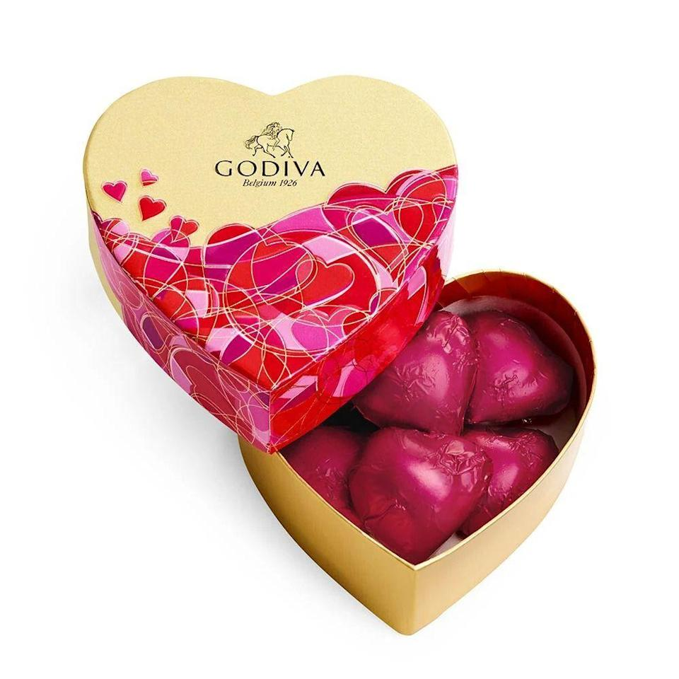 """<p><strong>GODIVA</strong></p><p>godiva.com</p><p><strong>$6.95</strong></p><p><a href=""""https://go.redirectingat.com?id=74968X1596630&url=https%3A%2F%2Fwww.godiva.com%2Fvalentines-mini-heart-chocolate-gift-box%2F13641.html&sref=https%3A%2F%2Fwww.bestproducts.com%2Feats%2Ffood%2Fg904%2Fvalentines-day-candy%2F"""" rel=""""nofollow noopener"""" target=""""_blank"""" data-ylk=""""slk:Shop Now"""" class=""""link rapid-noclick-resp"""">Shop Now</a></p><p>We are big fans of just about any chocolate treat from GODIVA, but especially chocolates that come packaged in a cute pink heart. This six-piece collection is the perfect gift for your coworkers or gal pals. </p>"""