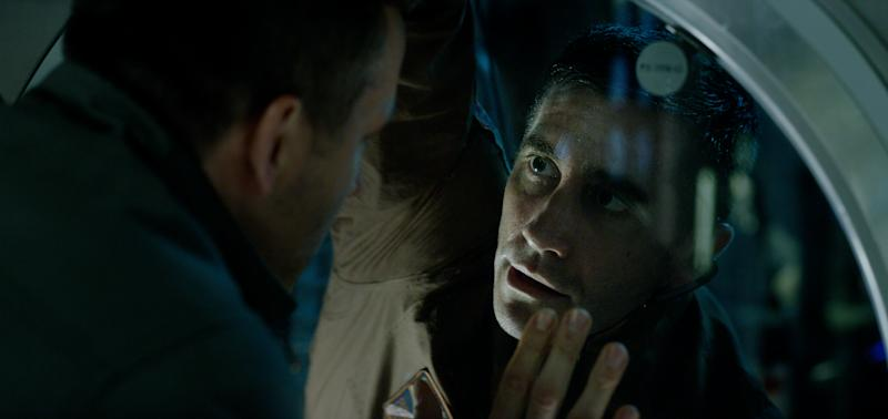 """In this image released by Columbia Pictures, Ryan Reynolds, left, and Jake Gyllenhaal appear in a scene from, """"Life."""" (Columbia Pictures-Sony via AP)"""