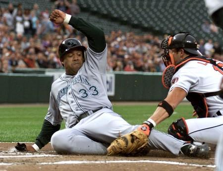 DEVIL RAYS PEREZ TAGGED OUT AT HOME BY ORIOLES LOPEZ IN BALTIMORE.