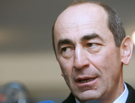 Armenia's President Kocharyan speaks to the media after casting his ballot at a polling station in Yerevan
