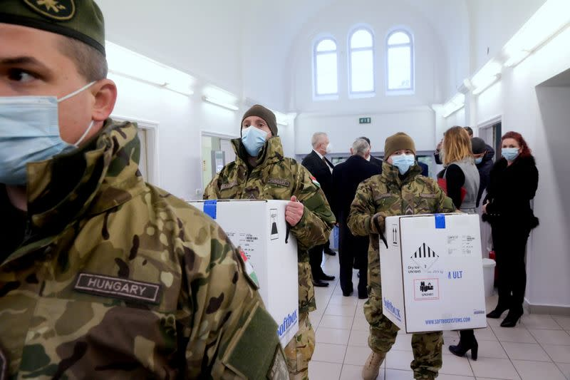 FILE PHOTO: Hungarian soldiers carry the first shipment of Pfizer-BioNTech coronavirus disease (COVID-19) vaccines at the Del-Pest Central Hospital in Budapest