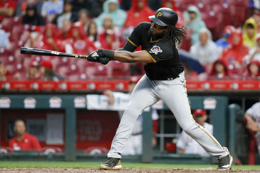 Pittsburgh Pirates' Josh Bell hits an RBI-double off Cincinnati Reds starting pitcher Anthony DeSclafani in the fourth inning of a baseball game, Saturday, July 21, 2018, in Cincinnati. (AP Photo/John Minchillo)