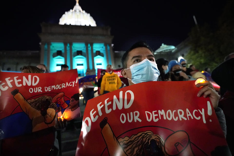 Hector Lugatero, of York, Pa., an Immigrant from Michoacan, Mexico, demonstrates outside the Pennsylvania State Capitol to urge that all votes be counted, Thursday, Nov. 5, 2020, in Harrisburg, Pa., following Tuesday's election. (AP Photo/Julio Cortez)