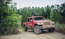 "<p>The new 2020 <a href=""https://www.caranddriver.com/jeep/gladiator"" rel=""nofollow noopener"" target=""_blank"" data-ylk=""slk:Jeep Gladiator"" class=""link rapid-noclick-resp"">Jeep Gladiator</a> builds on the four-door Wrangler's successful, appealing formula by adding a pickup bed to its tail. That also means a stretched wheelbase that seriously improves the everyday ride quality. It's the easiest Wrangler derivative to use and drive, and that made it a member of <em>C/D</em>'s 2020 10Best list. Like a proper Wrangler, the roof and doors can be removed. An optional disconnecting front anti-roll bar increases axle articulation over uneven terrain, and substantial 33-inch BFGoodrich KM all-terrain tires (optional) look cool and help with traction. Various trims are available up to the Rubicon model, ready to overwhelm most any mountain. The base engine is a 285-hp 3.6-liter V-6 with a six-speed manual transmission, but Jeep added a 260-hp 3.0-liter turbodiesel with an eight-speed auto only for 2021. </p>"