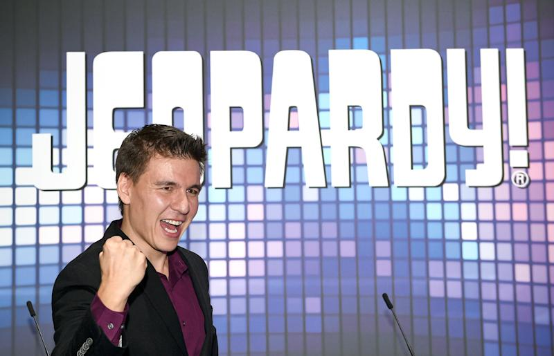 "LAS VEGAS, NEVADA - OCTOBER 15: Professional sports gambler and former ""Jeopardy!"" champion James Holzhauer poses at the IGT booth during the trade show debut of two ""Jeopardy!""-themed IGT slot machines during the Global Gaming Expo (G2E) at the Sands Expo and Convention Center on October 15, 2019 in Las Vegas, Nevada. (Photo by David Becker/Getty Images)"