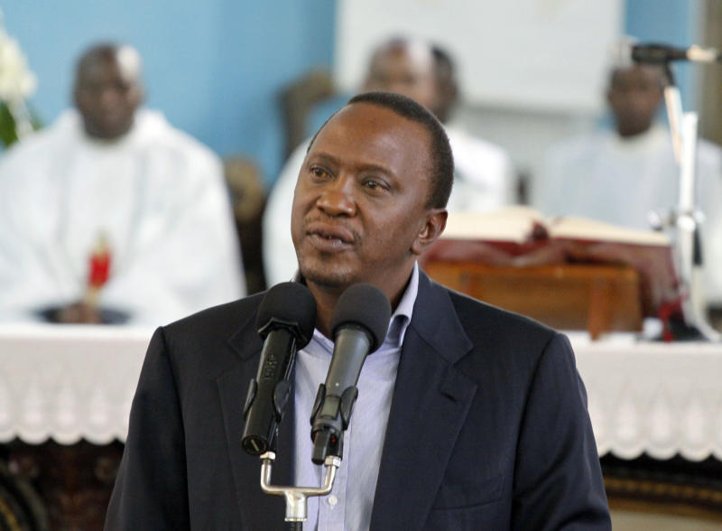 CORRECTS THE NAME OF THE CHURCH Kenya's President-elect Uhuru Kenyatta addressing the congregation after attending service at St. Austin catholic church, in Lavingtone, Nairobi, Kenya, on Sunday, March 31, 2013. Supporters of Kenya's Prime Minister Raila Odinga took to the streets on Sunday for a second day of protests against the Kenyan Supreme Court's decision to uphold the election of Uhuru Kenyatta as the country's next president. (AP Photo/Khalil Senosi)