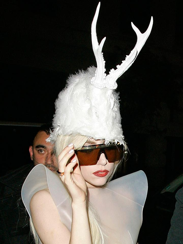 "Lady Gaga arrived at her London hotel wearing yet another one of her hideous headdresses. Doesn't it just make you want to sing, ""Gaga got run over by a reindeer ... "" <a href=""http://www.splashnewsonline.com"" target=""new"">Splash News</a> - December 6, 2009"
