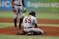 Detroit Tigers pitcher Gregory Soto kneels on the field after getting hit by the ball during the ninth inning of a baseball game against the Tampa Bay Rays Friday, Sept. 17, 2021, in St. Petersburg, Fla. (AP Photo/Scott Audette)