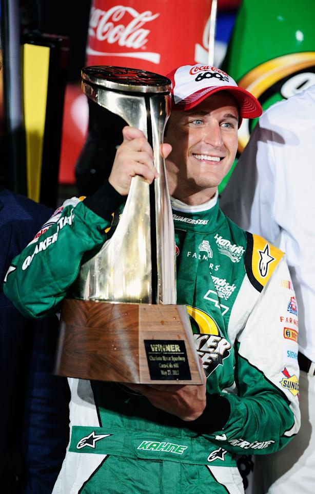CONCORD, NC - MAY 27:  Kasey Kahne, driver of the #5 Quaker State Chevrolet, poses with the trophy in Victory Lane after winning the NASCAR Sprint Cup Series Coca-Cola 600 at Charlotte Motor Speedway on May 27, 2012 in Concord, North Carolina.  (Photo by Jared C. Tilton/Getty Images for NASCAR)
