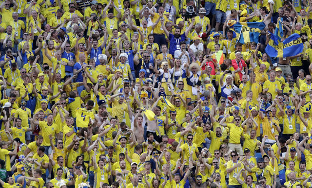 Sweden's fans celebrate Sweden's Andreas Granqvistt's goal during the group F match between Sweden and South Korea at the 2018 soccer World Cup in the Nizhny Novgorod stadium in Nizhny Novgorod, Russia, Monday, June 18, 2018. (AP Photo/Lee Jin-man)