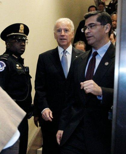 """<p>US Vice President Joe Biden arrives with Representative Xavier Becerra (R) to the US Capitol to meet with reluctant House Democrats on January 1, 2013 in Washington, DC. After fervent New Year brinkmanship, the US Congress Tuesday finally backed a deal to avert a """"fiscal cliff"""" of tax hikes and slashing spending cuts that had threatened to unleash economic calamity.</p>"""
