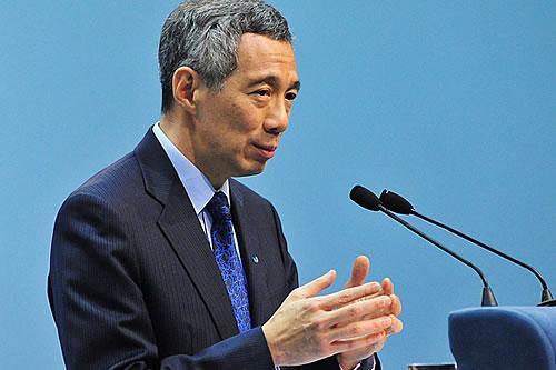 PM Lee says the government will not neglect the middle and lower income households. (Getty Images)