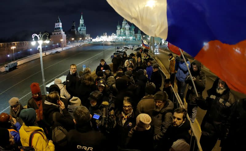 People gather at the site of the assassination of politician Boris Nemtsov while marking the fourth anniversary of Nemtsov's death in central Moscow