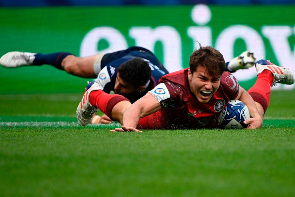 Toulouse's Antoine Dupont scores in the Heineken Champions Cup semi-final (AFP via Getty Images)
